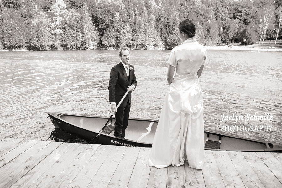 groom pulls up to bride in canoe