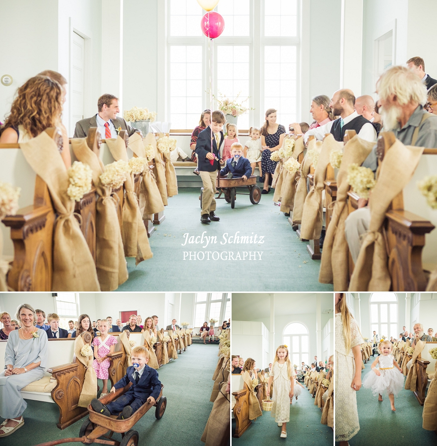 ringbearer pulled by red wagon unique wedding idea