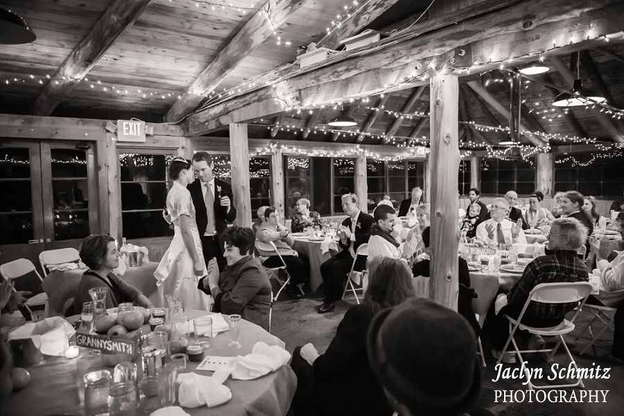 bride and groom thank their guests in barn reception