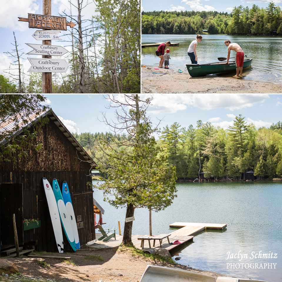 canoe and paddleboards lean against barn summer lake