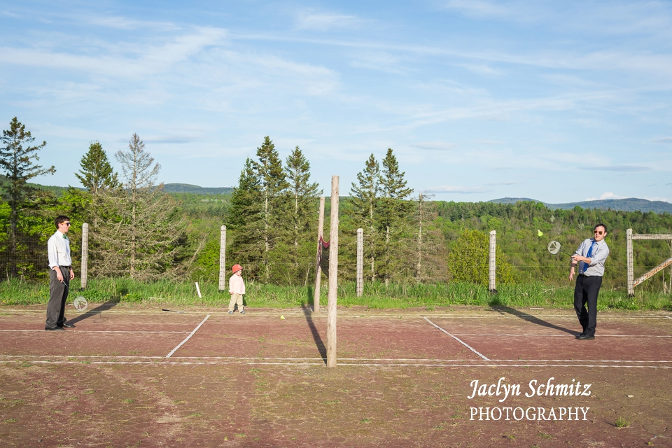 outdoor summer wedding guests playing racquetball