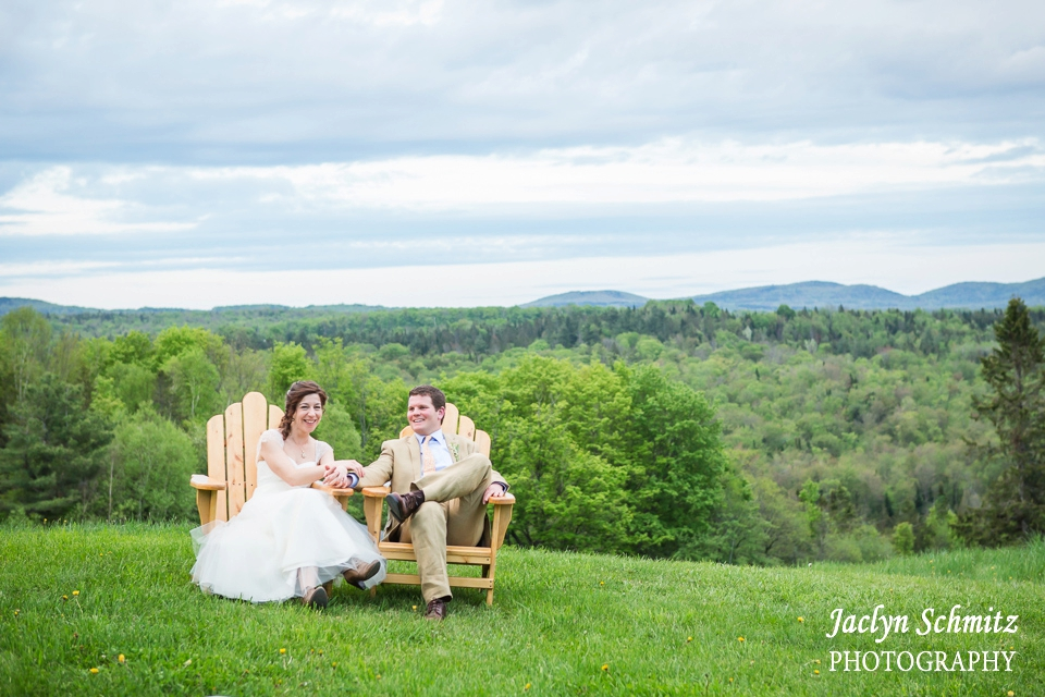 bride and groom sit in adirondack chairs sunny day