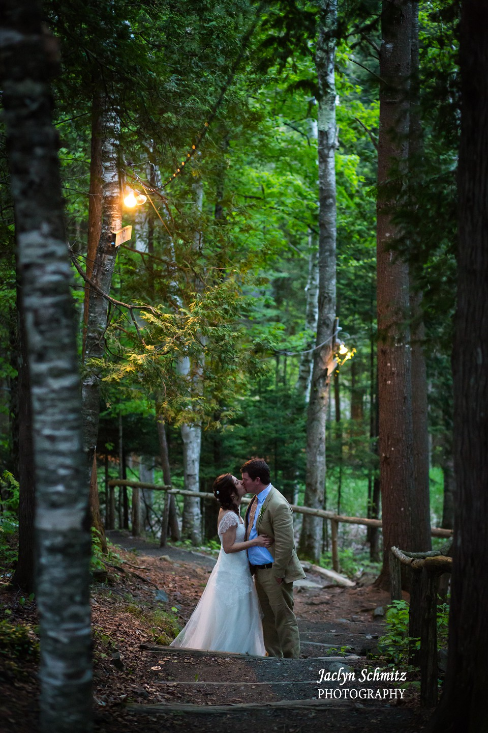 intimate wedding portrait in forest with glowing lights